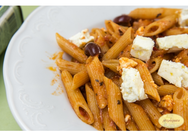 Penne with feta cheese , tomato and olives.